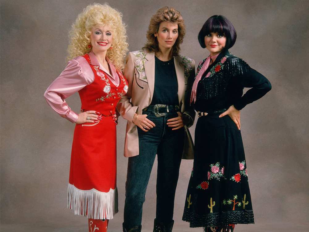 "Listen to Dolly Parton, Linda Ronstadt & Emmylou Harris' New Version of ""Wildflowers"" From ""Trio"" Collection"